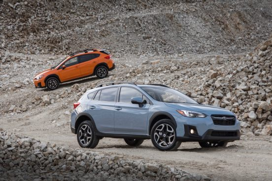 Image of two 2019 Subaru Crosstrek models parked on a rocky slope.